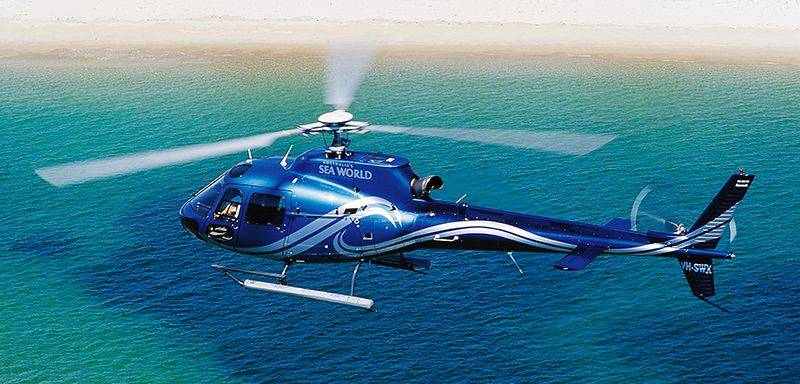 blue helicopter over the water